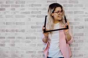 woman holding black photo frame