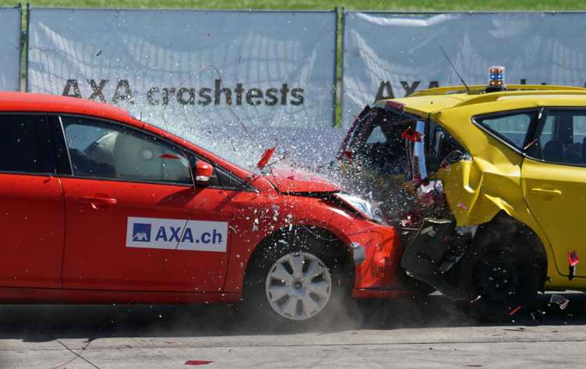 red and yellow hatchback axa crash tests