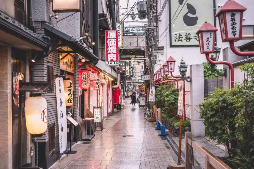 person walking on street near buildings
